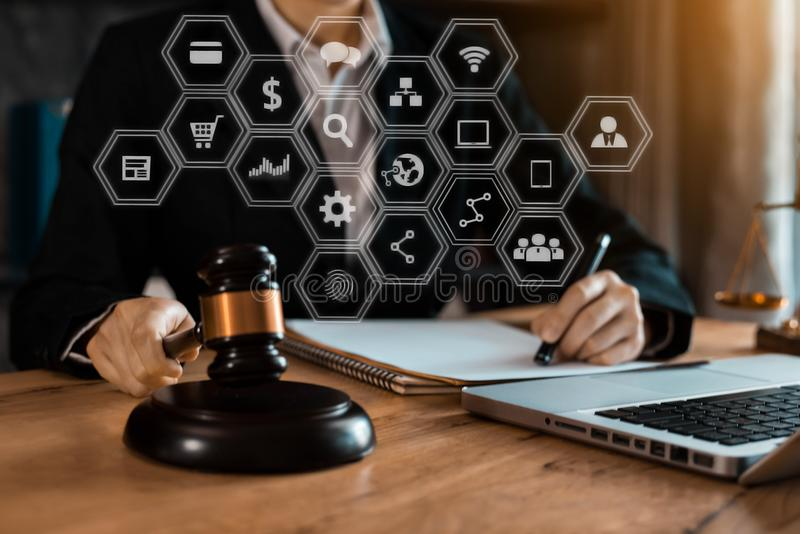 Justice and law concept. Female judge in a courtroom with the gavel working with digital tablet compute. royalty free stock photo