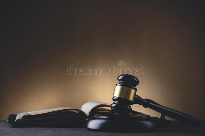 Justice and law concept. Judges gavel and law book on the table, toned image stock images