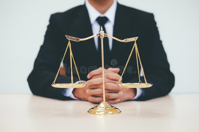 Justice and law concept. Male lawyer in the office with brass scale stock photos