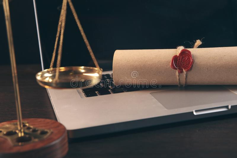 Justice and law concept.Lawyer workplace with laptop and documents with dark wooden. Justice and law concept. Lawyer workplace with laptop and documents with royalty free stock images