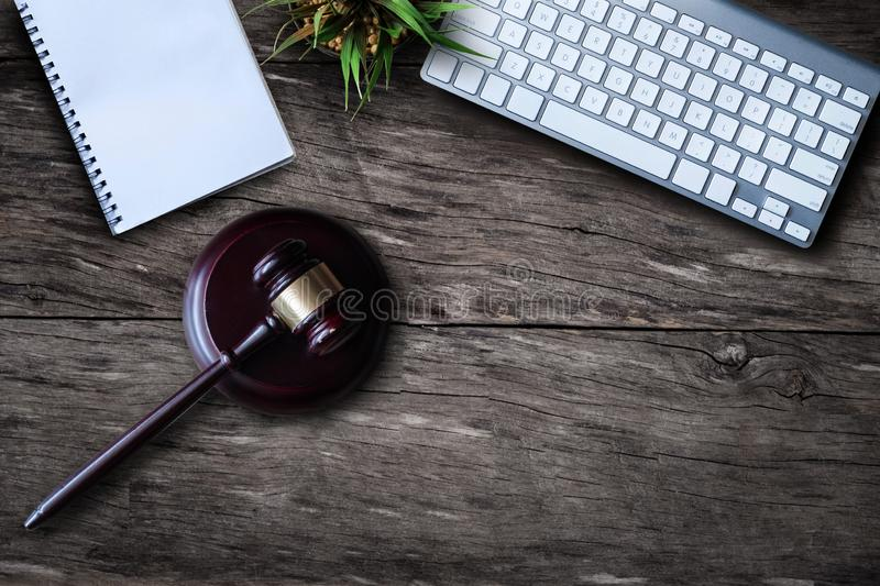 Justice and law concept.Lawyer workplace with laptop and documents with dark wooden. royalty free stock photography