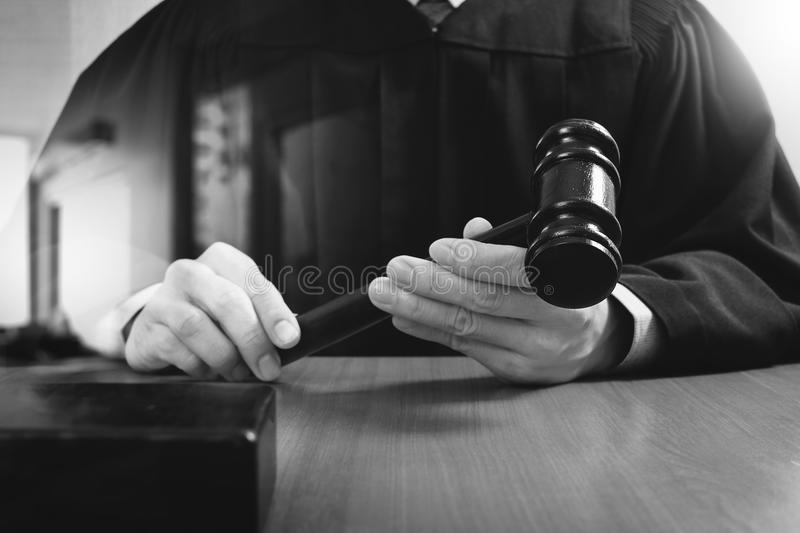 justice and law concept.Male judge in a courtroom striking the g royalty free stock photo