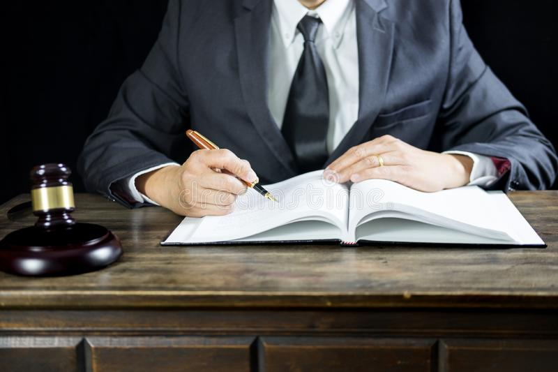 Justice and law concept.Male judge in a courtroom working on wood table with documents., attorney court judge justice gavel legal. Legislation concept stock photos