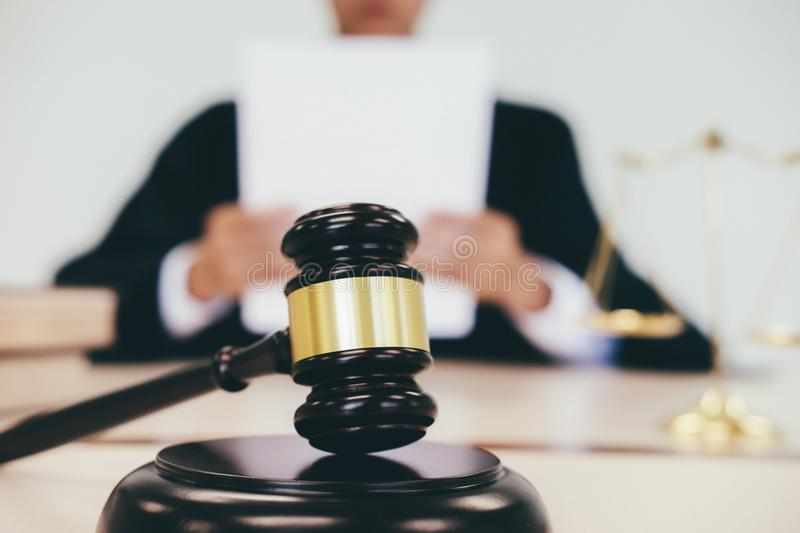 Justice and law concept. Male lawyer in the office with brass scale royalty free stock images