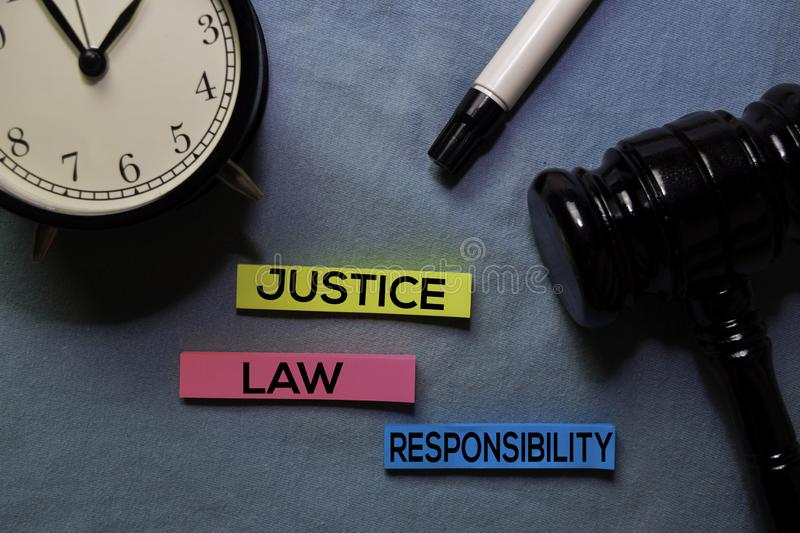 Justice, Law, and Responsibility on sticky notes and gavel isolated on office desk. Law concept stock photo