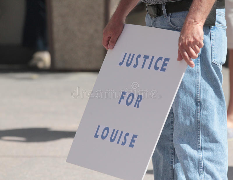 Justice for Louise sign. 19 year old man charged with first degree murder of Louise Sollowin, 93. Justice for Louise sign. FAIR - Federation for American stock photography