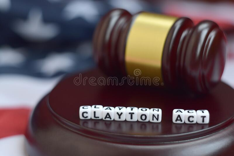 Justice mallet and Clayton act characters with US flag on background. Justice mallet and Clayton act characters close up with US flag on background stock image