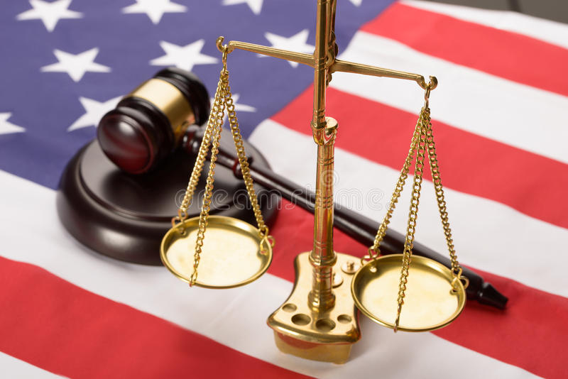 Justice scale and wood gavel on usa flag stock photo