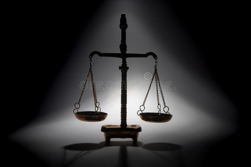 Justice scales or Libra - zodiac sign. Closeup, on dark grey background stock photography