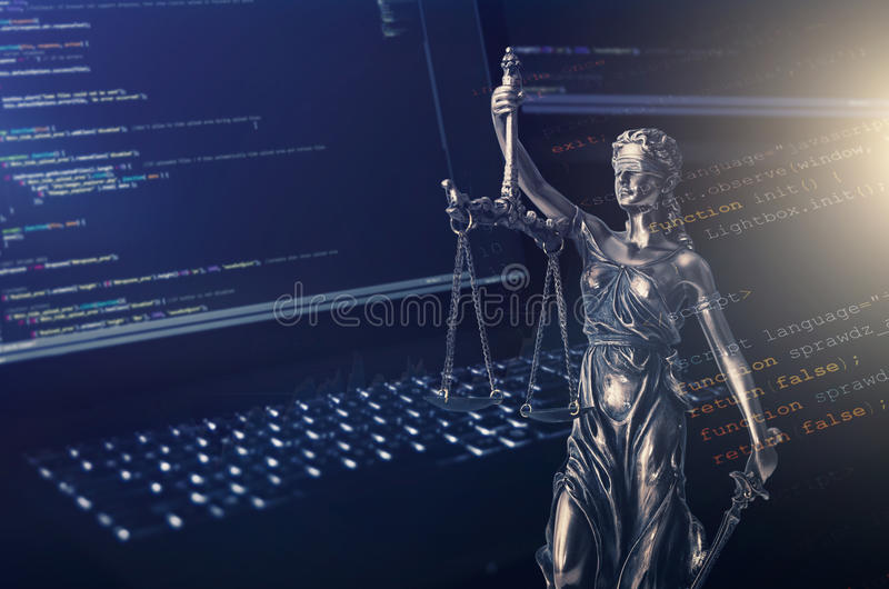 Justice statue with code on monitor device in background. Programming code law crime justice internet statue themis concept royalty free stock image