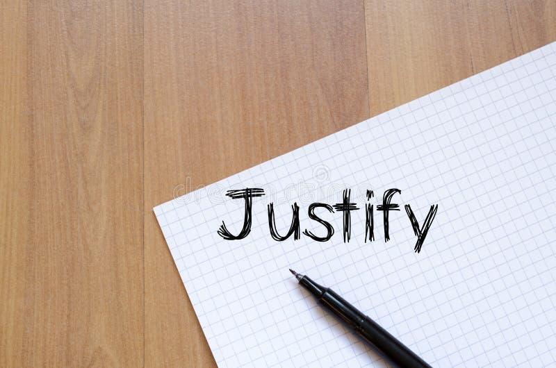 Justify écrivent sur le carnet images stock