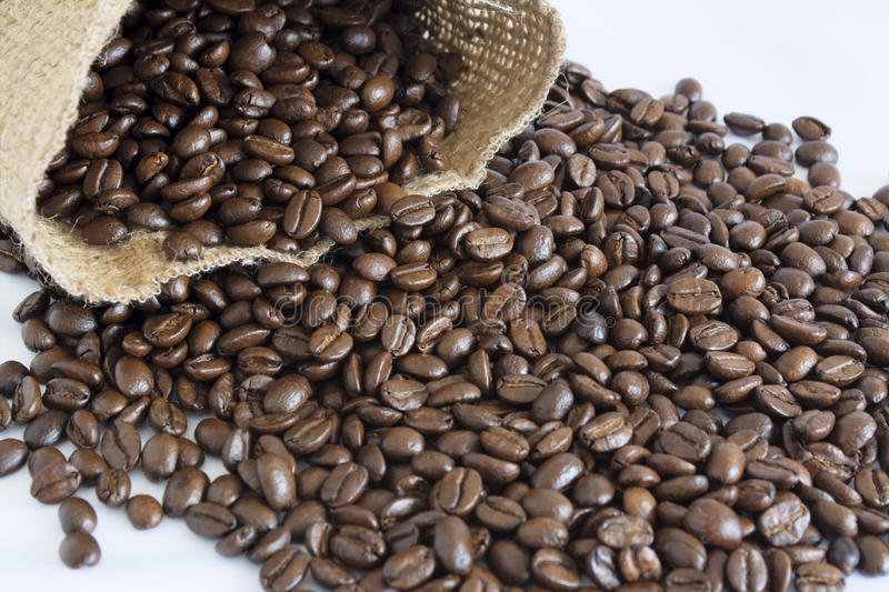 Jute bag and coffee beans II royalty free stock photo