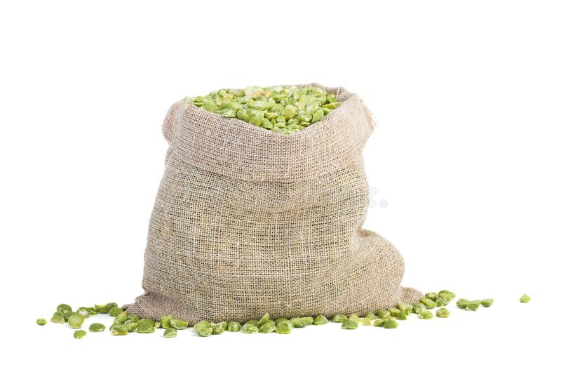 Jute bag with dried split green peas stock photo