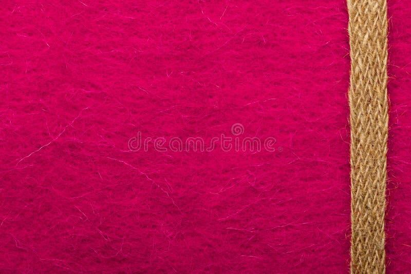 Jutekabel over roze achtergrond royalty-vrije stock afbeeldingen