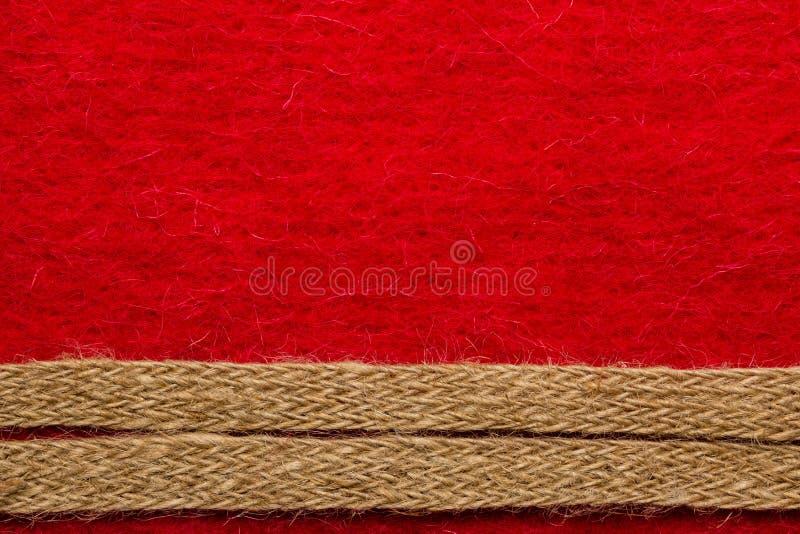 Jutowa arkana nad czerwonym tłem obraz stock