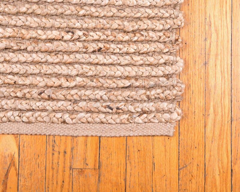 Jutowa palowa ręka wyplatający dywanik obraz royalty free
