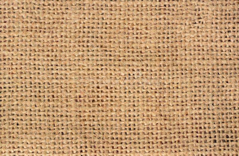 Jutowego burlap brązu brezentowa tekstura Tło dla teksta i obrazka zdjęcia royalty free