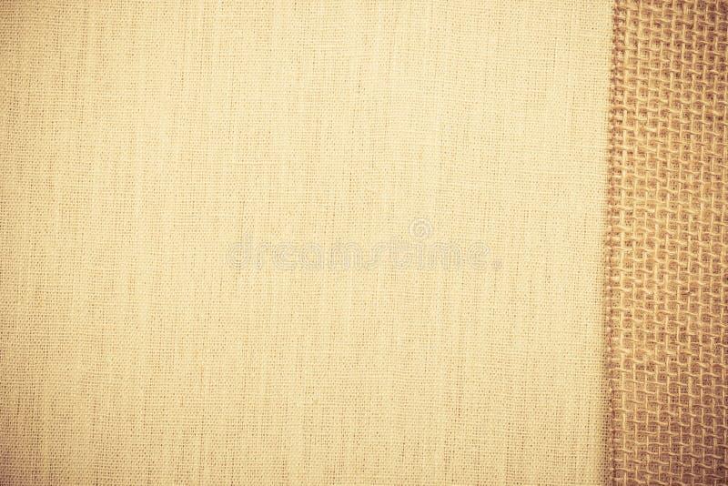 Jutowy faborek na bieliźnianego płótna tle obrazy royalty free