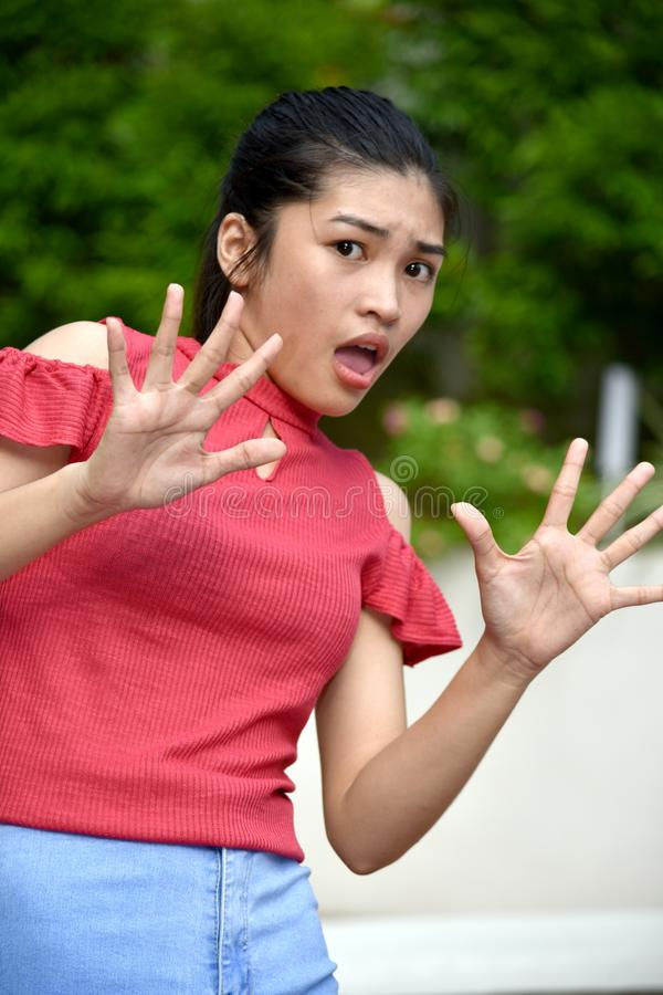 An A Juvenile And Fear. An attractive and asian person stock photos
