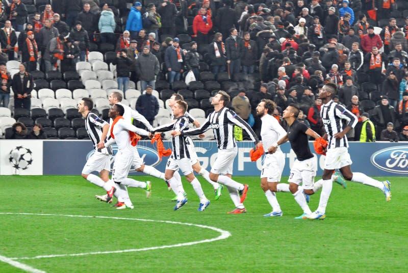 Juventus footballers som är rinnande på sätta in tillsammans arkivfoton