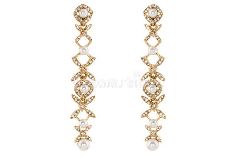 Juwelen op een witte achtergrond De premie van vrouwen` s oorringen met edelstenen Isoleer Juwelen Briljant royalty-vrije stock fotografie