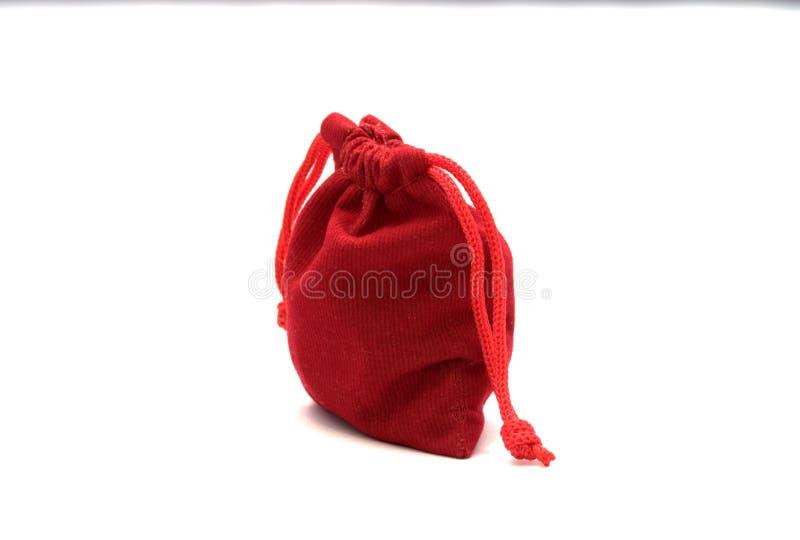 Juwelen rode zakken stock afbeeldingen