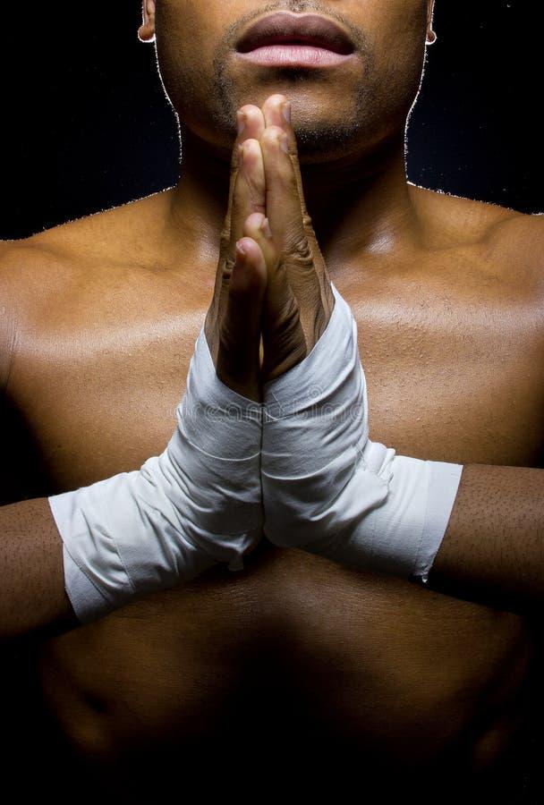Kämpe som ber för att segra fotografering för bildbyråer