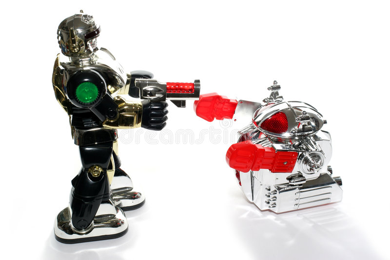 Kämpfen mit 2 Spielzeugrobotern lizenzfreie stockfotografie