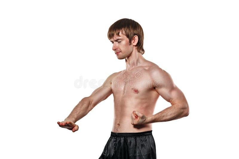 Kämpfer Kung Fu setzt niedrigeren Tritt des Blockes stockbild