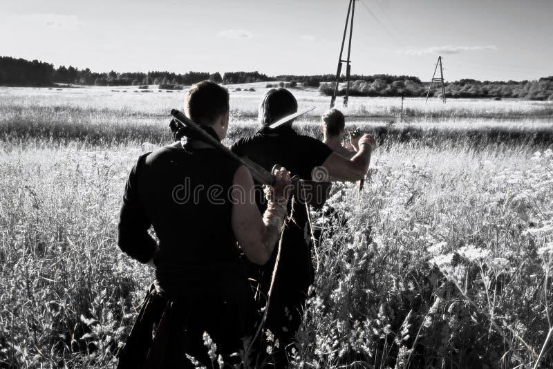Kämpfer mit Waffen stockfotografie