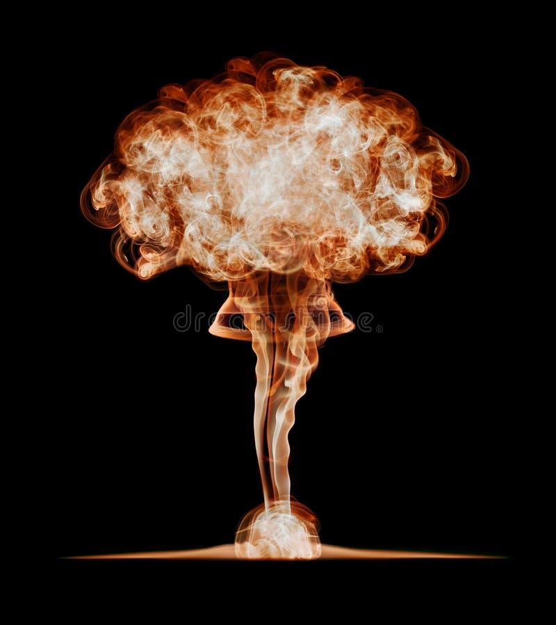 Kärn- explosion som isoleras på svart bakgrund arkivbild