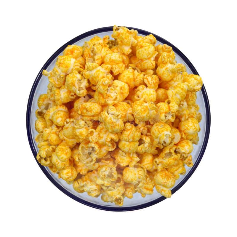 Käse gewürztes Popcorn in der blauen Schüssel lizenzfreie stockbilder