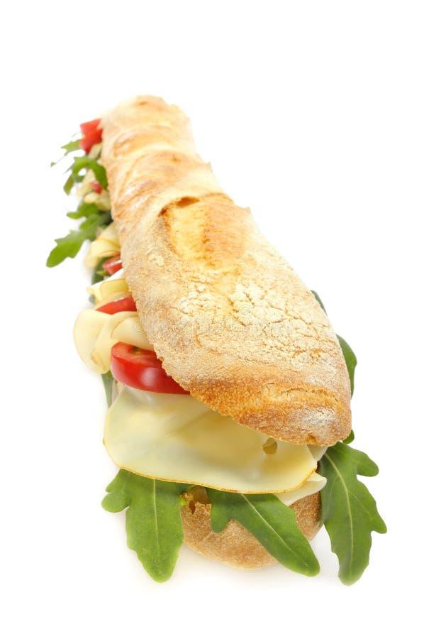 Käse- und Tomatestangenbrot stockfoto