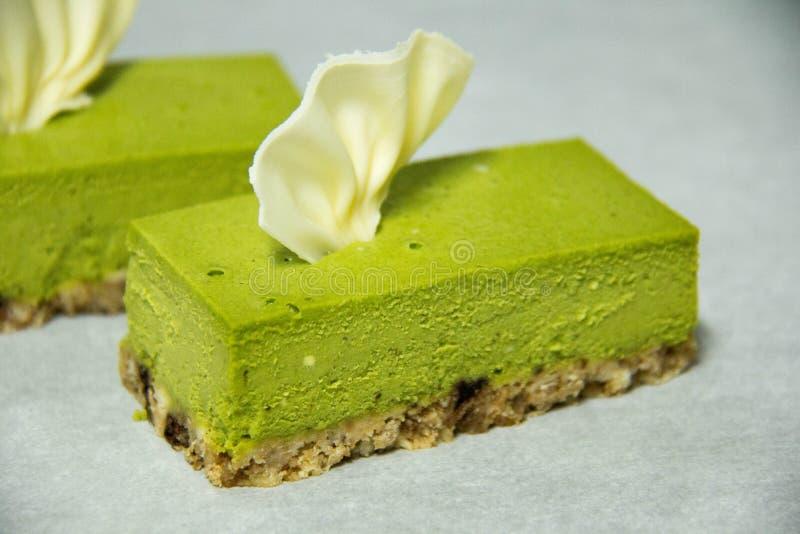 Käsekuchen des grünen Tees stockfoto