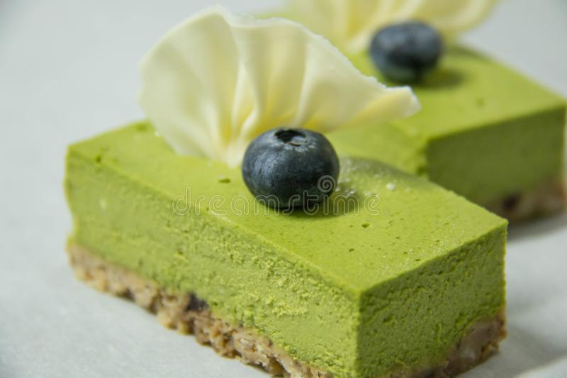 Käsekuchen des grünen Tees lizenzfreie stockfotografie