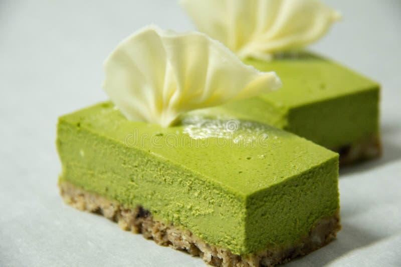 Käsekuchen des grünen Tees stockbilder