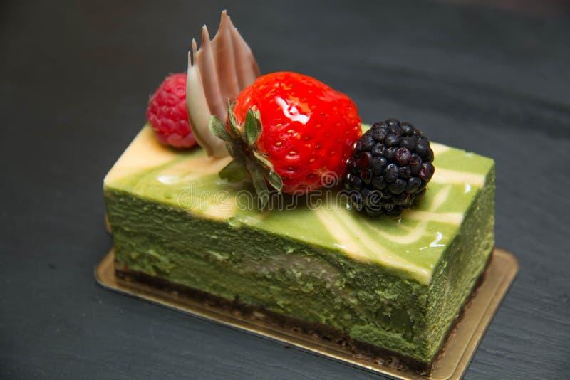 Käsekuchen des grünen Tees lizenzfreies stockfoto