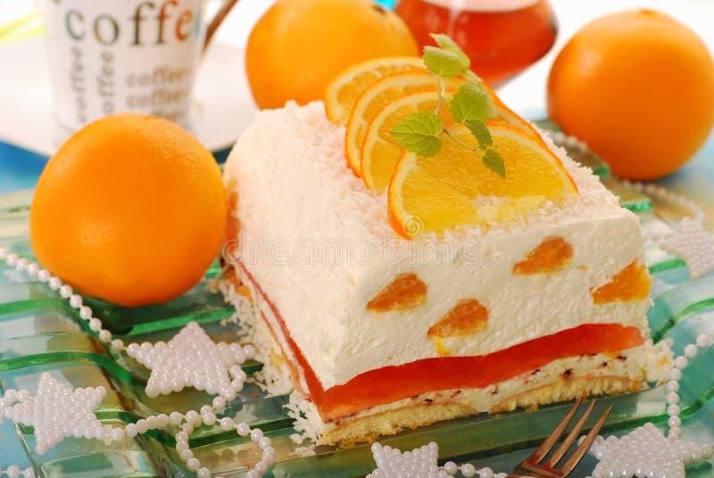 Käsekuchen mit Orangen und Gelee für Weihnachten stockbild