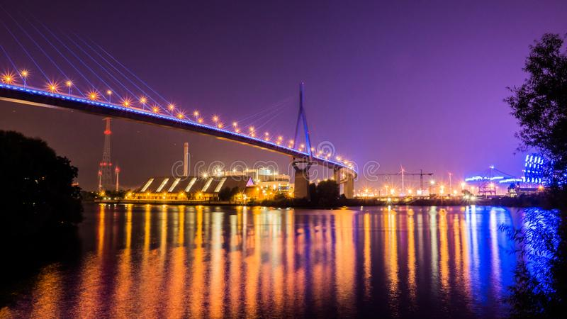 Illuminated Bridge in Hamburg. Köhlbrand-Bridge illuminated in Hamburg Harbor for Blue-Port stock photography