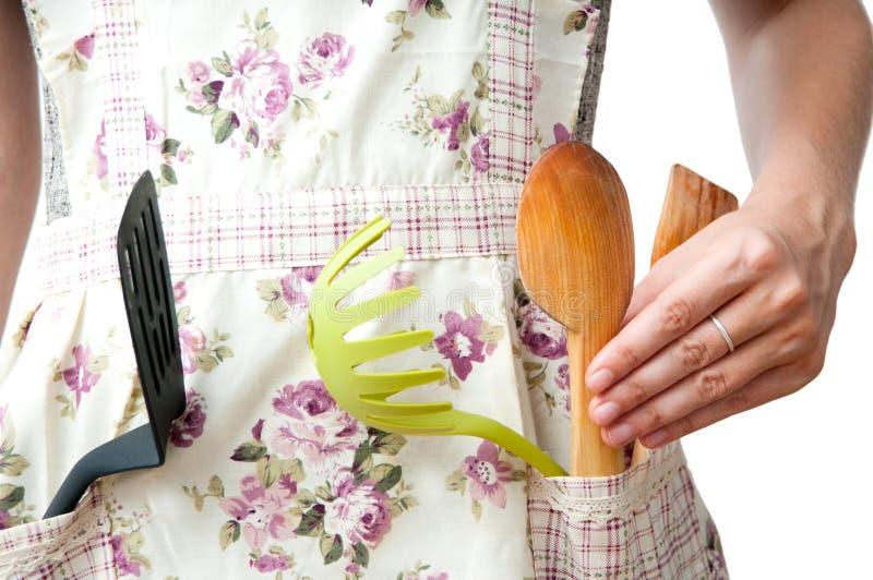 Kökämbetsdräkt och hjälpmedel arkivfoto