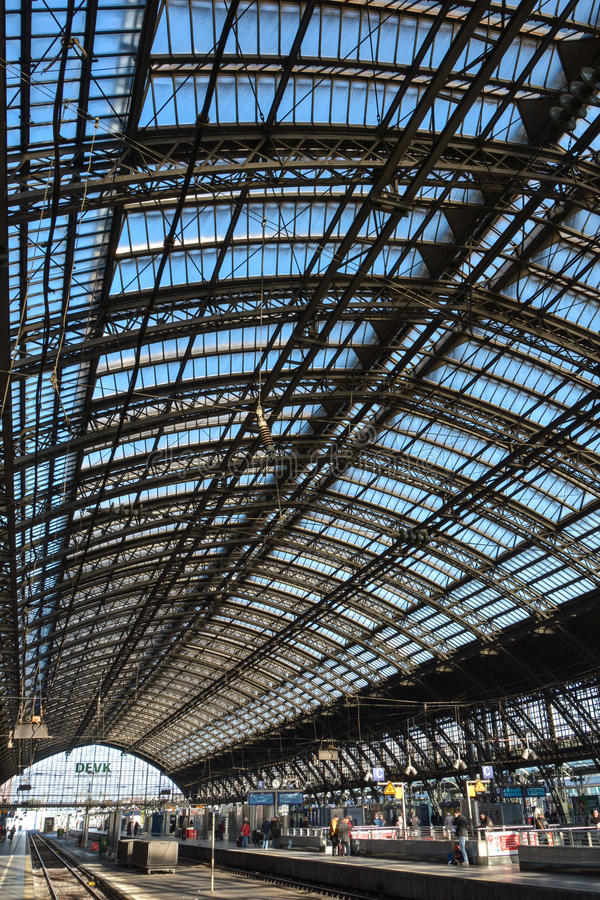 Köln Hauptbahnhof (4), Cologne, Germany. The main hall of the main train station in Cologne, Germany with its giant steel and glass roof through which stock image