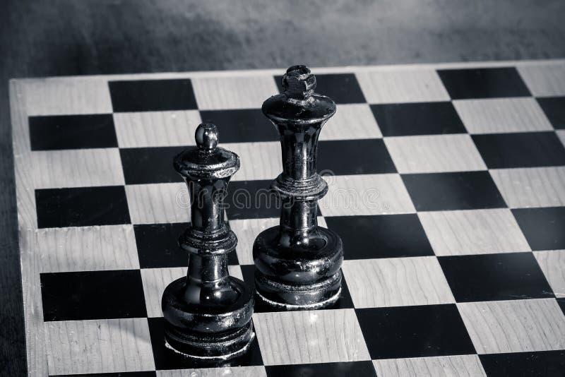 König und Königin - Schach lizenzfreie stockbilder