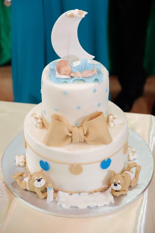 Königlich taufen Sie Kuchen mit Kerze stockfoto