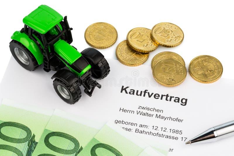 Köpekontrakt för ny traktor royaltyfri foto