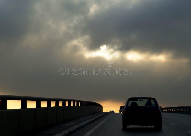körning av solnedgång royaltyfria foton