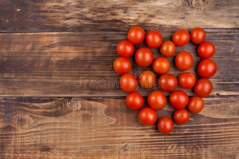 Körsbärsröda tomater royaltyfria foton