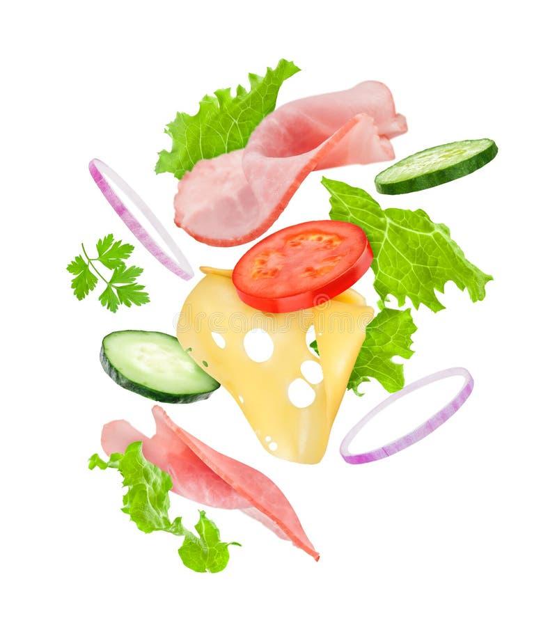 Köstliche Sandwichbestandteile fallen in die Luft auf lizenzfreie stockfotos