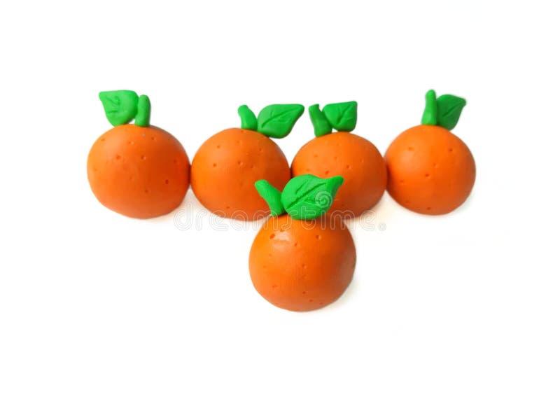 Köstlicher orange Plasticinelehm, vereinbart Linie, Einteiler höher lizenzfreie stockbilder