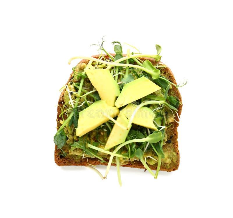 Köstlicher Toast mit Avocado auf weißem Hintergrund, Draufsicht stockfoto