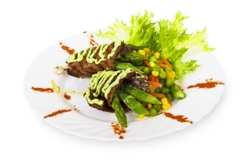 Kött som grillas med grönsaker royaltyfria foton